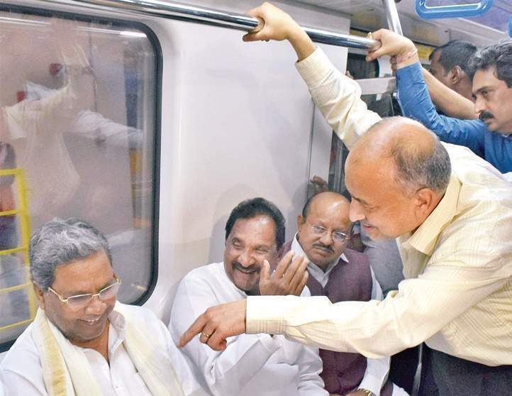 Chief Minister Siddaramaiah enjoys a Metro ride along with ministers and Metro MD (right) on Thursday | Pushkar V, JITHENDRA M