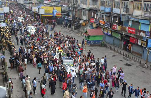 Activists of Gorkha Janmukti Morcha (GJM) take out a funeral procession with the bodies of their three activists who were killed Saturday in Darjeeling, India, Sunday. (Image   AP)