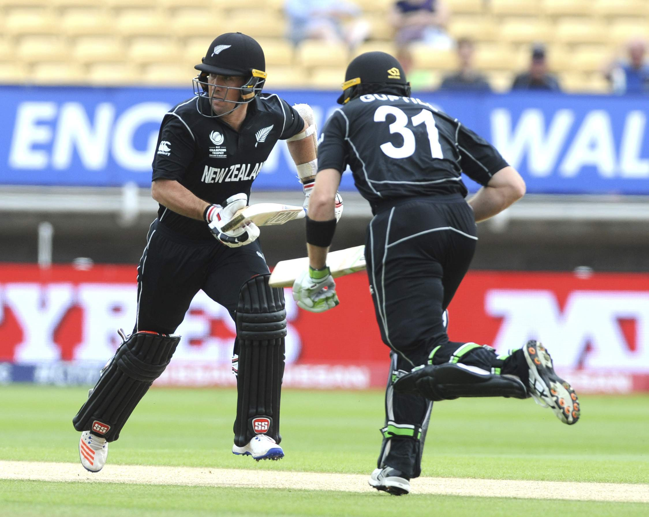 New Zealand's Martin Guptill, right, and New Zealand's Luke Ronchi run during the ICC Champions Trophy Group A match between Australia and New Zealand at Edgbaston in Birmingham. | AP
