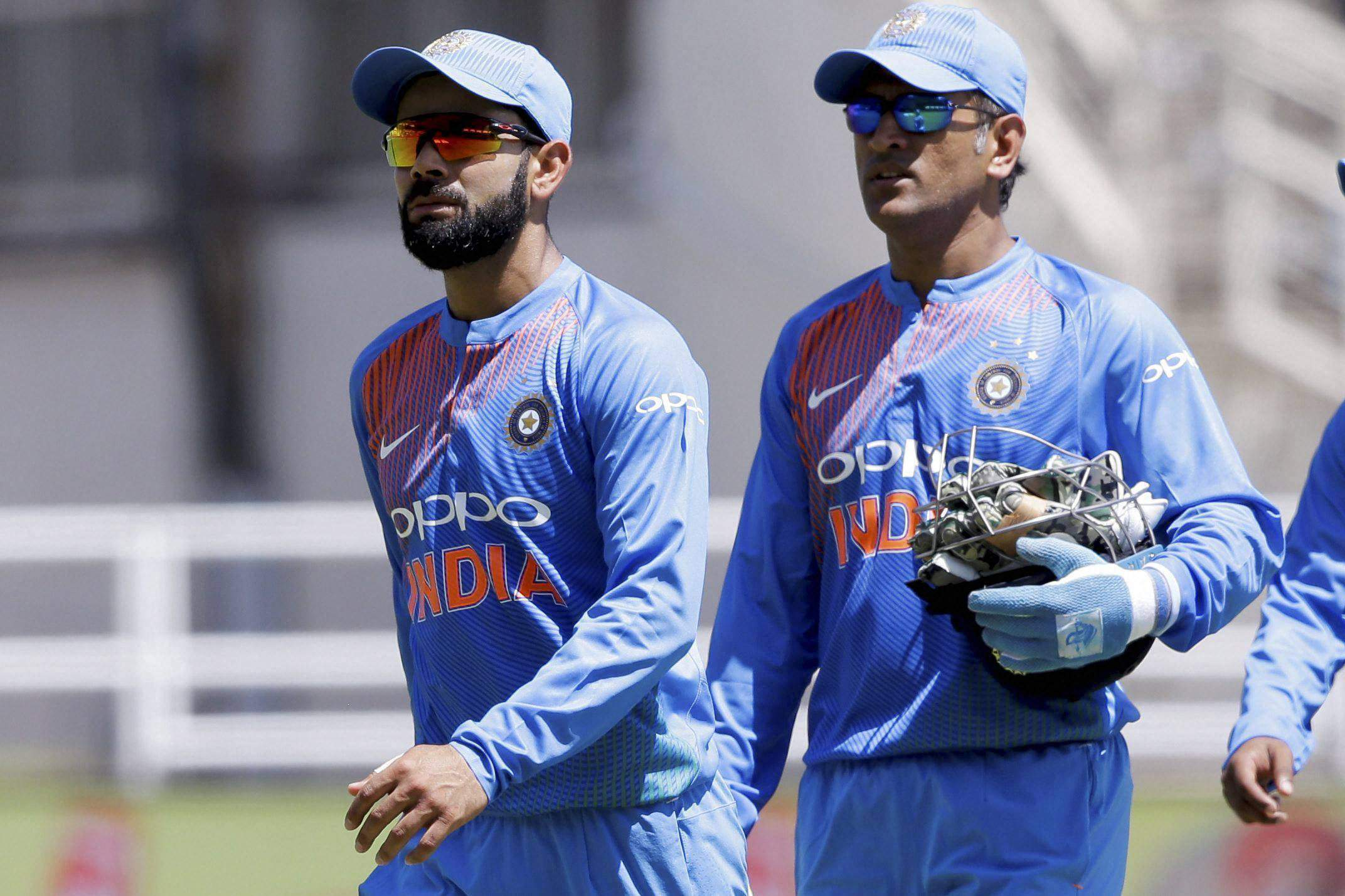 India's captain Virat Kohli left and wicket keeper MS Dhoni walk to the pavilion after losing to West Indies by 9 wickets a T20I at Sabina Park cricket ground in Kingston Jamaica.|PTI