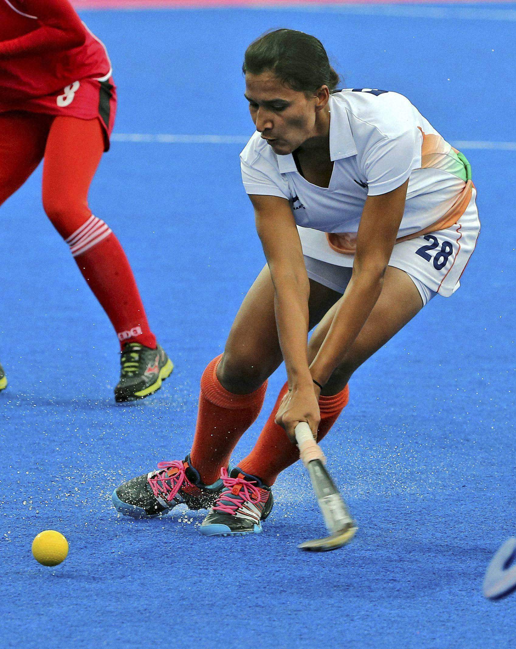 India's Ritu Rani plays a shot to score a goal in their match against Malaysia in the women's pool A match at the 17th Asian Games in Incheon - PTI Photo.
