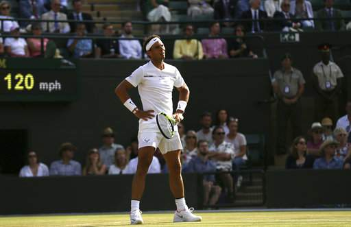 Spain's Rafael Nadal reacts after losing a point against Luxembourg's Gilles Muller on day seven at the Wimbledon Tennis Championships in London Monday, July 10, 2017. (AP Photo)