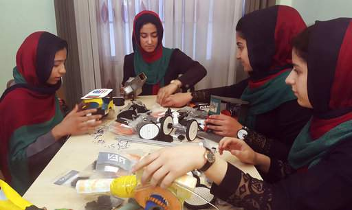 Teenagers from the Afghanistan Robotic House, a private training institute, practice at the Better Idea Organization center, in Herat, Afghanistan. U.S. President Donald Trump intervened to allow the group of Afghan girls into the country to participate in a robotics competition. White House spokeswoman Sarah Huckabee Sanders confirmed the president's intervention Wednesday, July 12, 2017. The six female students from Afghanistan had hoped to participate in an international robotics competition this month, but their visa applications to enter the U.S. were denied twice. (AP Photo)