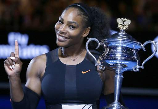 Serena Williams holds up a finger and her trophy after defeating her sister, Venus, in the women's singles final at the Australian Open tennis championships in Melbourne, Australia.|AP
