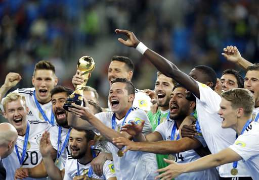 Germany's Julian Draxler holds the trophy after winning the Confederations Cup final soccer match between Chile and Germany, at the St.Petersburg Stadium, Russia, Sunday July 2, 2017. Germany won 1-0. (AP Photo)