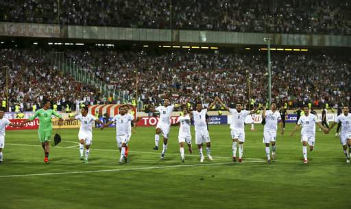 Iran national football team players celebrate after beating Uzbekistan in their Asia Group A, 2018 World Cup qualifying match.