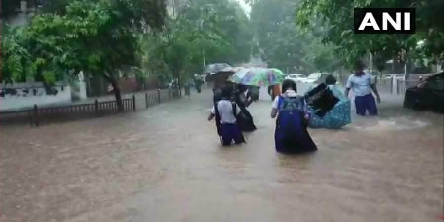 Mumbai Rains. School children, office goers were seen struggling to find there way as the streets are completely waterlogged.